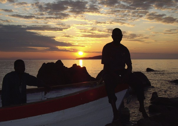 Sunset by the boats on Lake Malawi - Malawi - Meet the People Tours